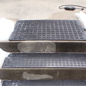 Hotflake heated mats on stairs with plug exposed