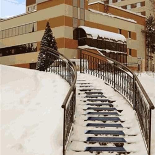 Hot-blocks heating mats placed on a snowy staircase