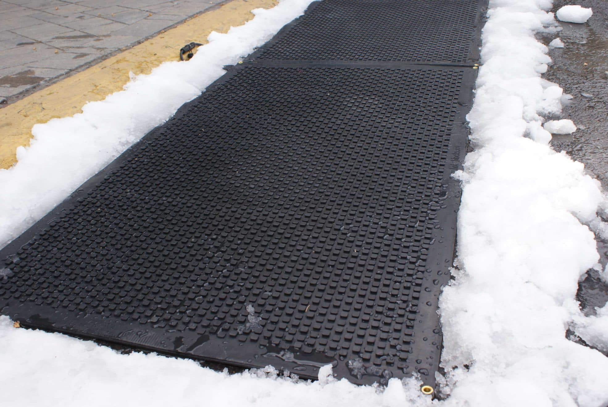 Heating Mat melting through snow on Winter day
