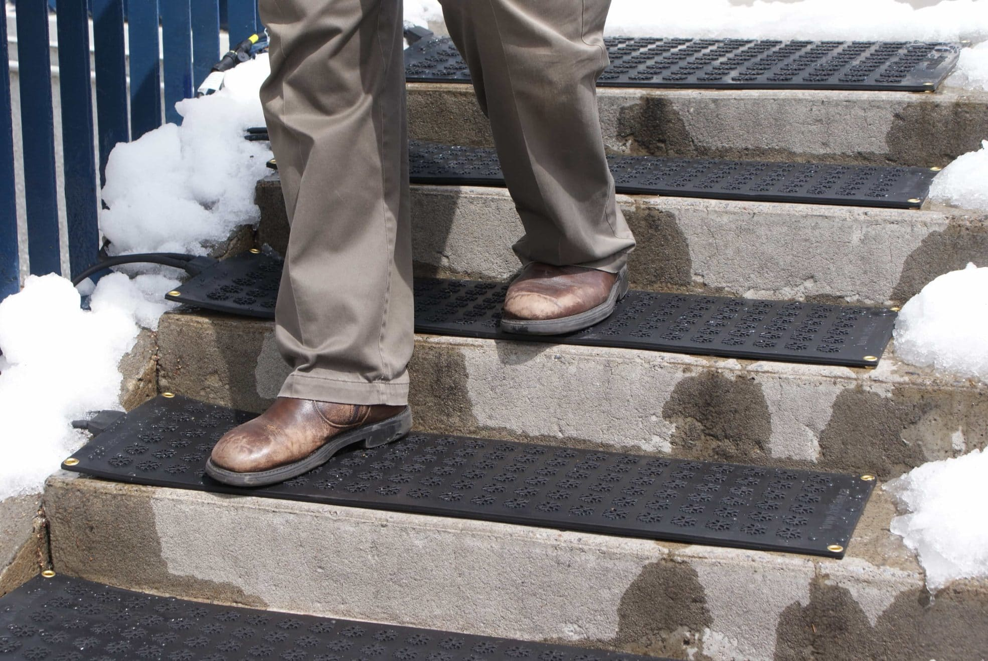 Close up of Older gentleman walking down stair case covered with heating mats