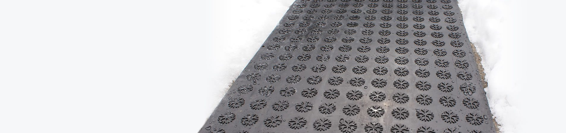 Hotflake mat on walkway surrounded by snow