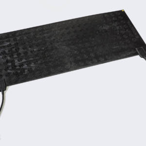 KEMF Heated passageway mat sitting on table